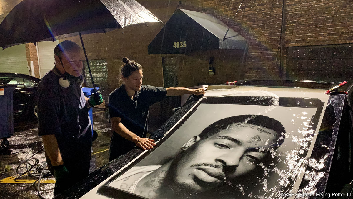 This image shows Matthias St. John and second generation photography teacher Tom Strimbu performing the final 'rinse' of a life size print on the back of Matthias' car on a conveniently rainy night. Come Join us Friday, October 25, 2019, at Panormaic Images in Skokie for the opening of his show: Silver Gelatin Mural Prints