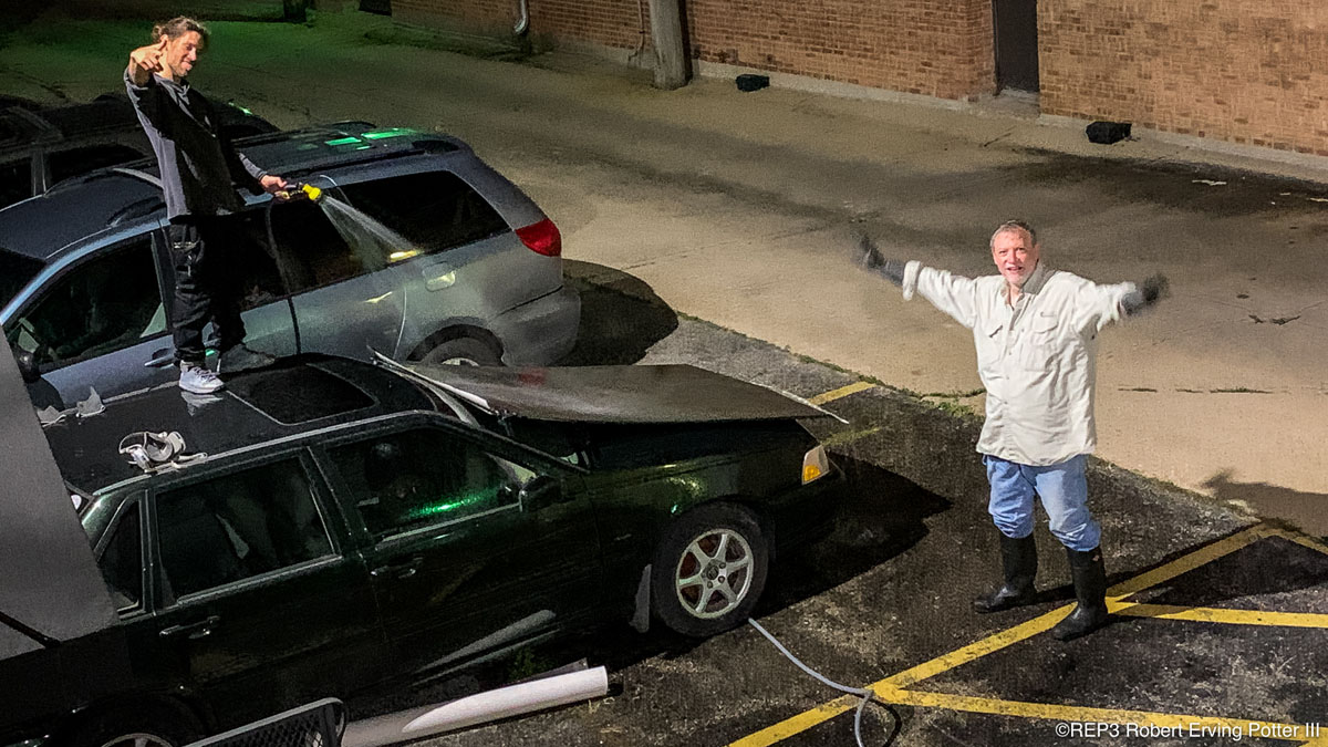 Matthias St. John (standing on car left) and second generation photograper & teacher Tom Strimbu (right) performing the final 'rinse' of a life size print on the back of Matthias' car on a conveniently rainy night. Come Join us Friday, October 25, 2019, at Panormaic Images in Skokie for the opening of his show: Silver Gelatin Mural Prints