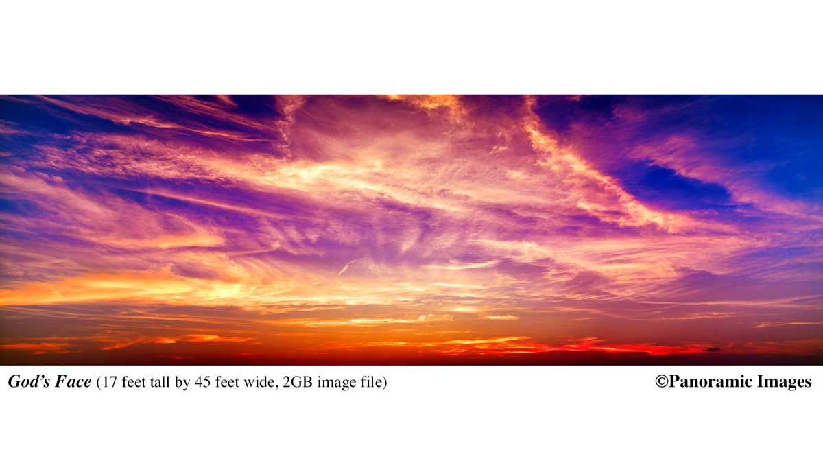 """Picture of a sunset with clouds on fire, orange, yellows and dark black shades, entitle 'God's Face', the image is 17 feet tall by 45 feet wide and was created by stitching together four images made from a 6""""x17"""" transparancy. For more information on Panoramic Images go to: https://panoramicimages.com For more information on the Potter School of Photography, call: 312-226-2060"""